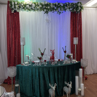 Crystal chandelier draping backdrop .