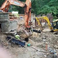 Contractor preparing dwarf structural appurtenances for load test.