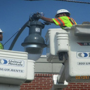 Installing mast arm and Tear drop light fixture at MLK and Parkland St, SE
