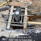Conduit between DDOT MH-E to L-10. (NW 16th. & Columbia)