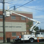 Installation of mast arm on SB MLK in front of the Petey Greene Center.