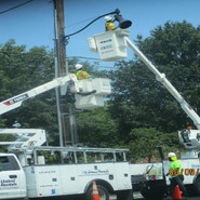 Installing mast arm and Tear drop light fixture on a wood pole at MLK and 5th St, SE