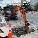 Excavating trench for conduit between DDOT MH-G and TS4. (SE 16th. & Columbia)
