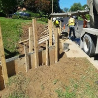 Contractor at Phase 1 on Dogwood Street, prepared for the dwarf wall installation.