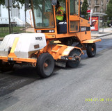 Clean milling  loose soil at 16th St  NW.