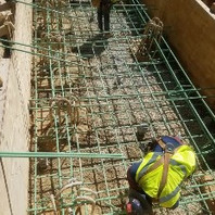 Contractor at Phase 3 retaining wall #3 on graded #57 stone placed formwork and re-bar.