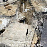 Conduit between DDOT MH-F & TS2 (pushbutton). (NE 16th. & Columbia)