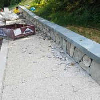 Contractor continued placing Stone Masonry gladding on PCC Coping Wall.