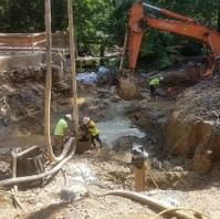 Contractor at Bridge South Abutment drilled Caissons and poured concrete.