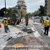 Hammering pavement to prepare for conduit trench between DDOT MH-E & TST. (NW 16th. & Columbia)