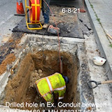 Drilled hole in Ex. Conduit between MH 568160 & MH 568317 to allow lead string to be pulled through conduit blockage.