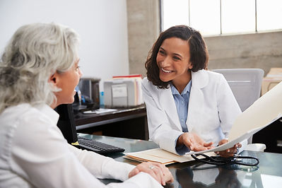 smiling-female-doctor-in-consultation-wi