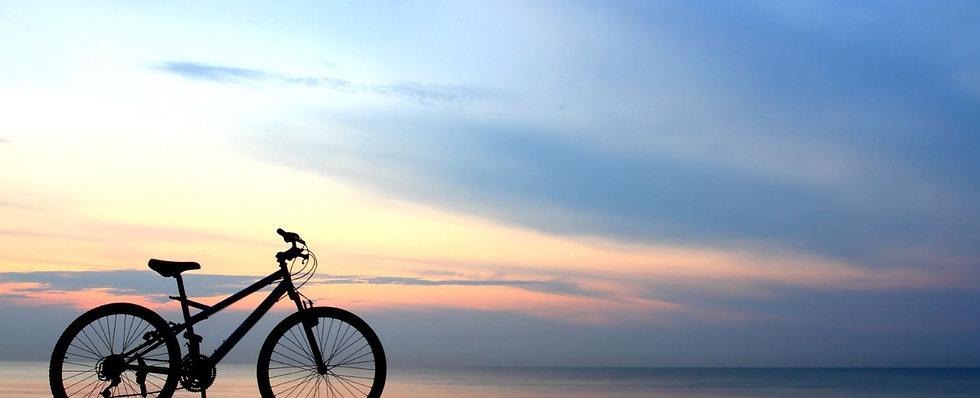 bike-on-a-beach-1-1500x609.jpg