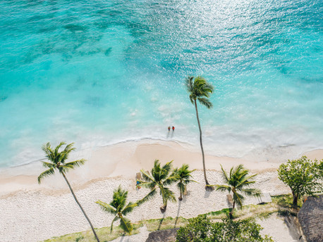 """What does a travel agent do on a """"business"""" trip to the Dominican Republic?"""
