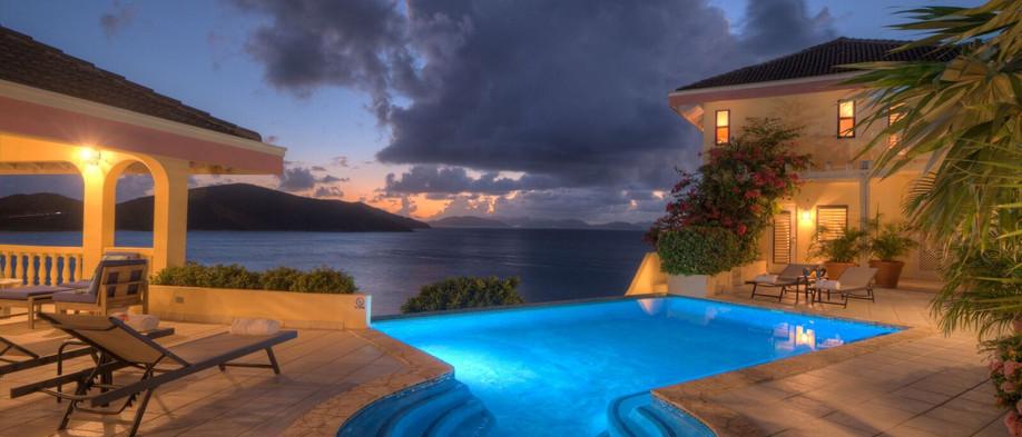 nightime infinity pool overlooking Sir Francis Drake Channel