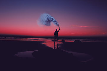 Person on Beach with Cloud of Smoke