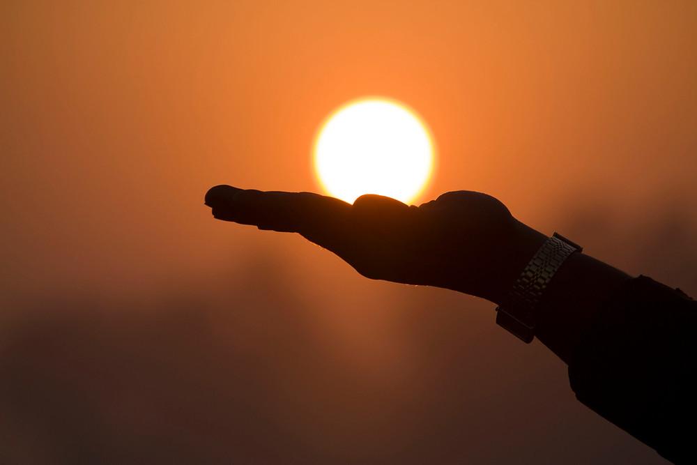 Hand Holding the Sun
