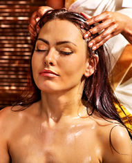 Young woman having head ayurveda spa tre