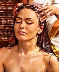 Young woman having head ayurveda spa tre