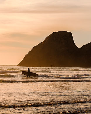 Surfer at Camel Rock by Jillian Butolph.