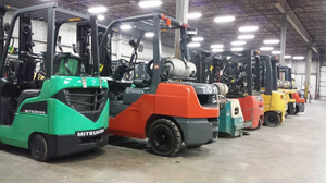 a row of forklifts - Mitsubishi, Toyota, Yale, Linde