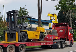 15 ton forklft on a trailer