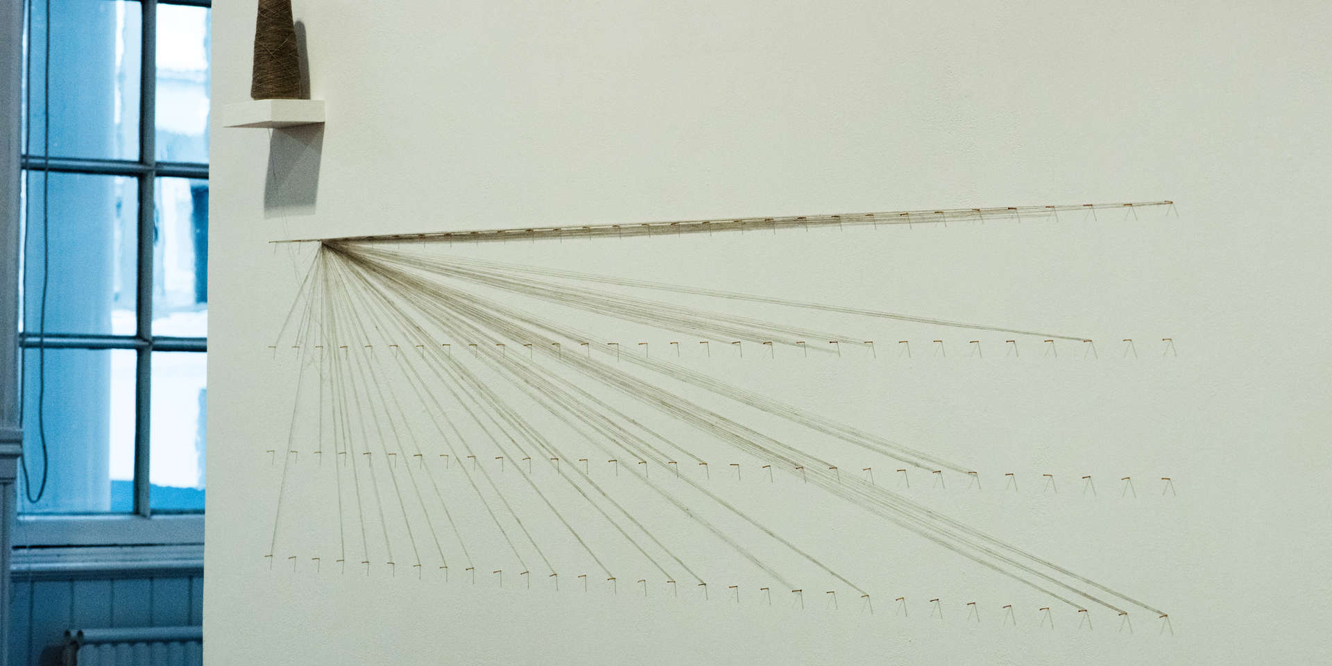 Strands of Thought, (detail1); nails, wool, tags, clips, digital imagery; 430x240cm; photo A Thompson; Fiona Percy 2018