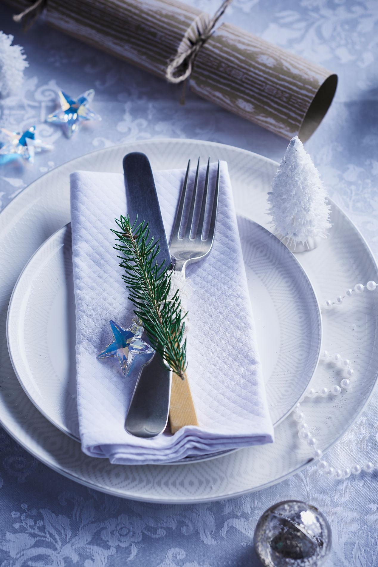 Crisp white Christmas table setting