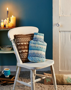 Knitted cushion and quilted cover