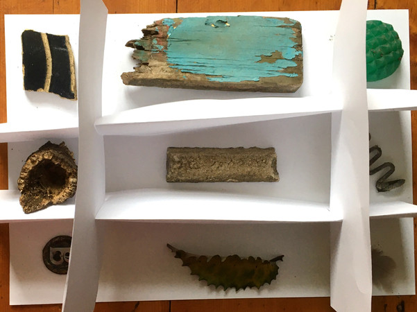 Paper display of earth collection