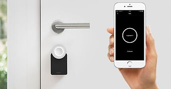 Nuki smart Lock and Smart phone showing App
