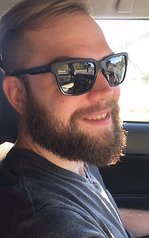 Photo of peter mason wearing sunglasses and smiling