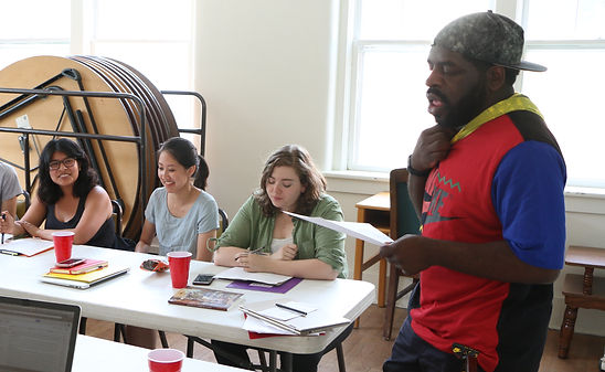 Hanif Abdurraqib leading workshop at the Open Mouth Poetry Retreat. Thanh Bui, Anna Binkowitz, and Hannah Campolo-Rich appear in background
