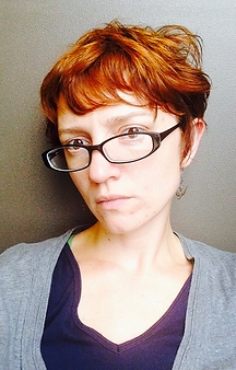 Photo of Amie Whittemore wearing glasses facing left
