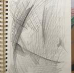 Using a charcoal pencil.