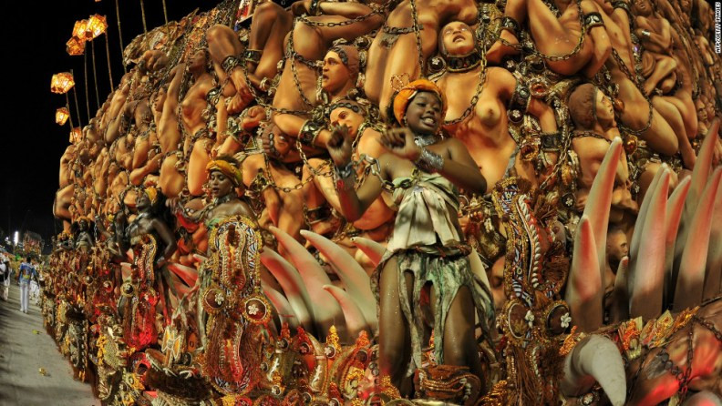 Dancers from a samba school on a float representing enslaved Africans