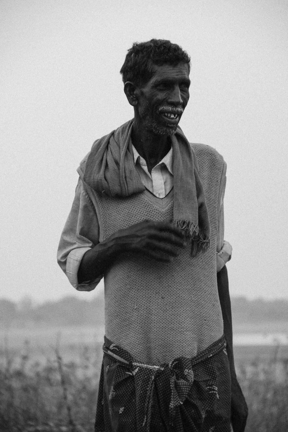 a farmer smiles