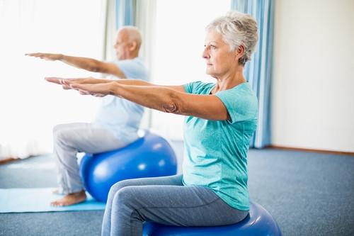 seniors practicing balance on stability balls