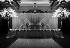Stunning Top Table Curtains, complet with LEDS, Swags and Draping. SublimeFlowe Walls in Various Colour an Finishes. We can also transform  your Wedding Venue with complete Wall Drapes