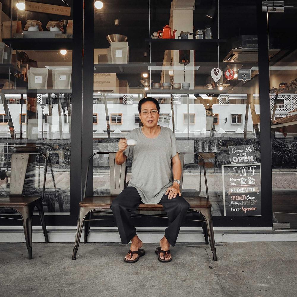 Mr. Tan enjoying a cup of coffee