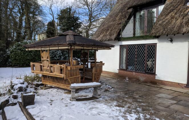 Tiki Hut in a thatch cottage garden