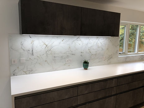 Lighting under high rise wall cabinets helps to bring the modern kichen to life
