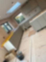 Installation of kitchen begins, designed by Liquid Space Design.