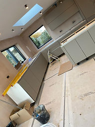 Installation of kitchen begins, designed by Liquid Space Design.