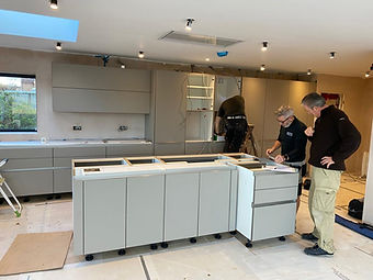 Richard Stone, designer at Liquid Space Design, checking over the kitchen plans before installation is finished