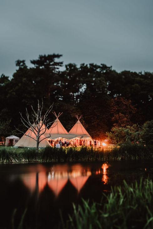 Tipi Wedding: Tipis across lake at night