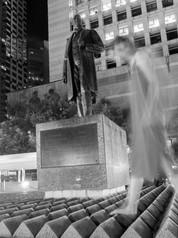 Self-portrait with statue of Sir Thomas Jackson, photograph.