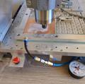 Vacuum base holding PCB while milling.