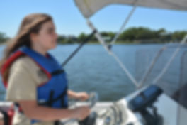 Student piloting a boat