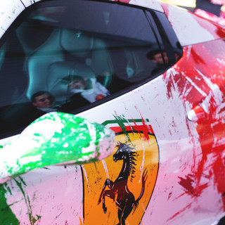 Italia flag covering Ferrari